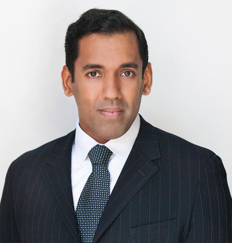 Sunil Oommen in suit Headshot